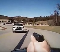 Video: Okla. officer opens fire as vehicle rams into him