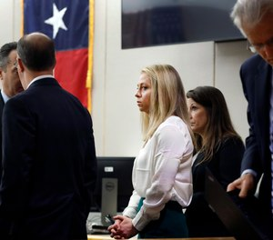 Former Dallas police officer Amber Guyger, center, appears in court on Saturday, September 28. (Photo/AP)