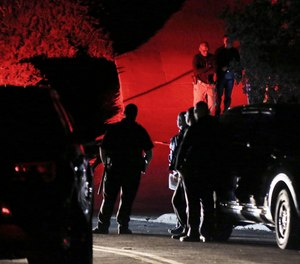 Contra Costa County Sheriff deputies investigate a multiple shooting in Orinda, Calif. that left four dead and four wounded. (Photo/AP)