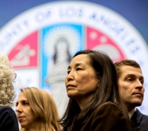 Sachi Hamai, CEO of LA County (center) and Sheriff Alex Villanueva clashed over whether the county should pay officers who dipped into their personal sick leave for COVID-19-related quarantine. (Photo/TNS)