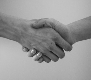 An inmate has just received his GED and reaches out to shake your hand. How do you respond? (Photo/Pixabay)