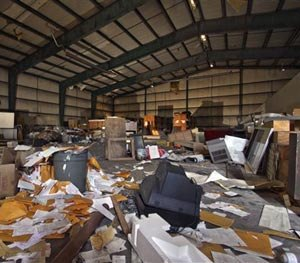 Debris is strewn about the main room inside the airport hangar on abandoned Birchwood Resort grounds in Pocono Township, Pa., Tuesday, Nov. 4, 2014, where where accused Pennsylvania State Trooper killer Eric Frein was arrested last Thursday.