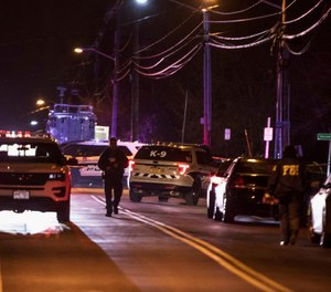 Authorities gather on a street in Monsey, N.Y., Sunday, Dec. 29, 2019, following a stabbing late Saturday during a Hanukkah celebration. (Photo/AP)