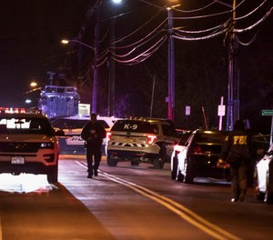Authorities gather on a street in Monsey, N.Y., Sunday, Dec. 29, 2019, following a stabbing late Saturday during a Hanukkah celebration.