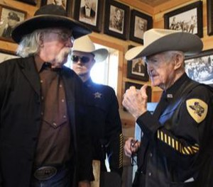 Deputy Bill Hardin, right, is being honored with his own exhibit at the Chisholm Trail Museum in Cleburne. The exhibit in his honor calls him the