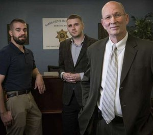 Investigator Jacob Walker, from left, analyst Anthony Bush and manager Brad Rudolph make up the new Harris County Sheriff's Office's Behavioral Threat Assessment Unit, which targets stalkers and potentially dangerous situations. (Photo/TNS)