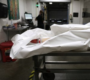 A body is processed at the Pierce County Medical Examiner's office in Tacoma, Washington. (Christina House/ Los Angeles Times/TNS)