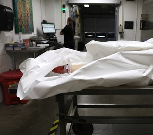 A body is processed at the Pierce County Medical Examiner's office in Tacoma, Washington.