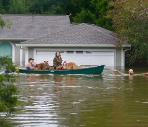 A family evacuates their Meyerland home in Houston.