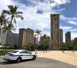 Hawaii law enforcement authorities are cracking down on rogue tourists who are visiting beaches, jetskiing, shopping and generally flouting strict requirements that they quarantine for 14 days after arriving. (Photo/AP)