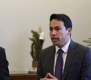 Hawaii state Rep. Chris Lee, chairman of the House Judiciary Committee, wants to examine how the man who fatally shot two Honolulu police officers last week was able to access weapons. (Photo/AP)