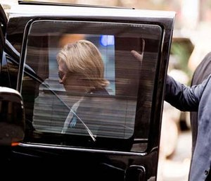 Democratic presidential candidate Hillary Clinton gets into a van as she leaves an apartment building Sept. 11.