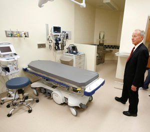 In this June 25, 2013 file photo, Jeffrey Beard, secretary of the California Department of Corrections and Rehabilitation, looks over an emergency care room while touring the California Correctional Health Care Facility in Stockton, Calif.