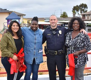 Deputy chief Nick Borges is pictured with residents from the Del Monte Manor in Seaside, California.