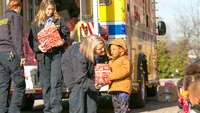 Photo of the Week: Kids receive gifts from 'Polar Express' ambulance