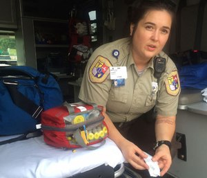 In this Aug. 28, 2016 photo, Cabell County EMT Tabitha Perez demonstrates how medics administer naloxone to overdosing patients, in Huntington, W.Va.