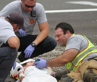 Photo: Firefighter plays 'Happy Feet' to calm injured child