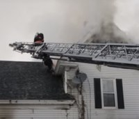 Video: Maine firefighter falls through roof, rescued