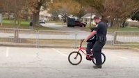 Video: NC police officer helps boy learn to ride bike