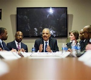 U.S. Attorney General Eric Holder, center, meets with law enforcement and community leaders for a roundtable discussion at Ebenezer Baptist Church, Monday, Dec. 1, 2014, in Atlanta.