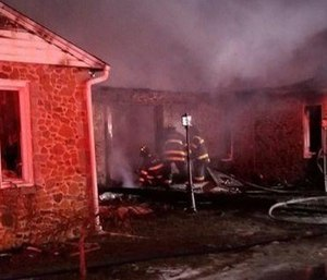 A mayday call went out Monday after an assistant chief fell through the floor of a burning home while searching for occupants.