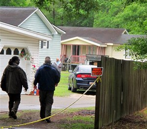 Investigators work at a scene of a shooting in Hollywood, S.C., Thursday, May 7, 2015. (AP Image)
