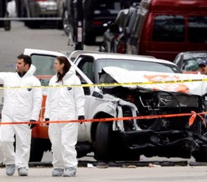 Law enforcement personnel examine the scene Wednesday, Nov. 1, 2017, after a driver mowed down people on a riverfront bike path near the World Trade Center on Tuesday in New York. (AP Photo/Mark Lennihan)