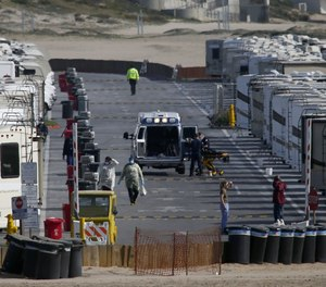 More than 100 RVs are parked at Dockweiler State Beach in Los Angeles to house people who have tested positive or have symptoms of COVID-19. Many of the patients are homeless.