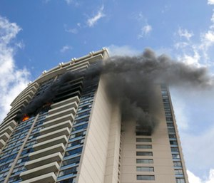 The Department of Health confirmed this week that the 36-story building contained asbestos when more than 120 firefighters responded to the seven-alarm fire that killed three residents. (Photo/AP)