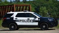Police: Woman resisting arrest bit a patrol car, kicked officers
