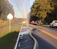 Pa. driver faces fines for running over fire hose