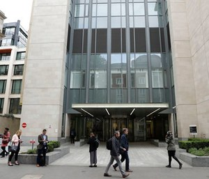 An exterior view shows the main entrance of St Bartholomew's Hospital, in London, one of the hospitals whose computer systems were affected by a cyberattack. (AP Photo/Matt Dunham)