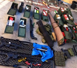 This undated photo released Wednesday, Aug. 21, 2019 by the Long Beach, Calif., Police Department shows weapons and ammunition seized from a cook at a Los Angeles-area hotel who allegedly threatened a mass shooting. (Long Beach Police Department via AP)
