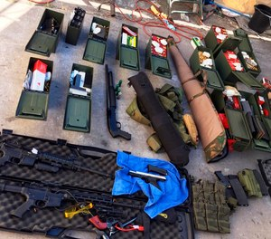 This undated photo released Wednesday, Aug. 21, 2019 by the Long Beach, Calif., Police Department shows weapons and ammunition seized from a cook at a Los Angeles-area hotel who allegedly threatened a mass shooting.