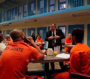 Soldier On president John Downing talks with inmates inside the veteran's pod at the Albany County Correctional Facility, Monday, Nov. 27, 2017, in Albany, N.Y. (AP Photo/Julie Jacobson)