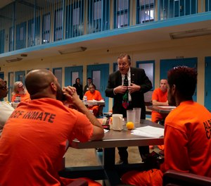 Soldier On president John Downing talks with inmates inside the veteran's pod at the Albany County Correctional Facility, Monday, Nov. 27, 2017, in Albany, N.Y.