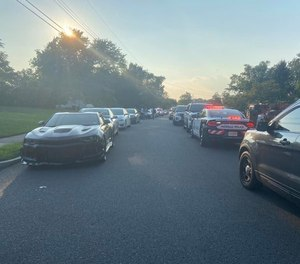 Police arrive at a New Jersey mansion to shut down a pool party attended by 300 people August 9, 2020.
