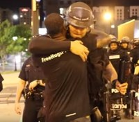 Hope amidst the riots: How a hug between a cop and an activist sparked a movement