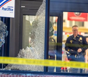 A police officer and civilian took down a man who entered a crowded supermarket after firing shots at vehicles outside.