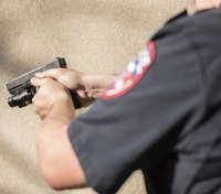 Officer justified in shooting man with gun to his own head?