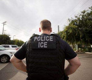 In this July 8, 2019, file photo, a U.S. Immigration and Customs Enforcement (ICE) officer looks on during an operation in Escondido, Calif. (Photo/AP)