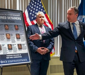 Matthew Albence, right, the acting director of U.S. Immigration and Customs Enforcement,  blamed the