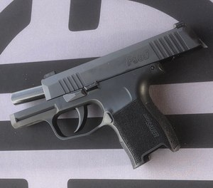 The carefully sculpted grip, trigger guard undercut, and effective beavertail of the Sig P365 make it behave exceptionally well in recoil. (Photo/Sig Sauer)