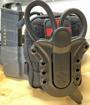 Mounting XShears to your IFAK with a Tactical Holster will make sure they are there when you need them.