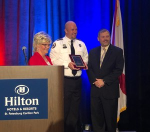 Joshua Hoover was honored for his actions after performing life-saving skills on a young girl who had been pulled from the water at a water park. (Photo/Courtesy of Sunstar Paramedics)