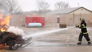 FR1 Editor-in-Chief Rick Markley takes on the car-fire prop at Hennepin Technical College. (Photo/Story of us Films)