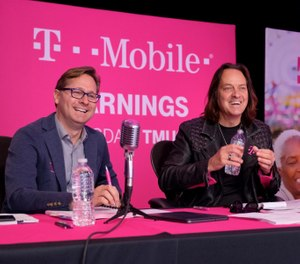 T-Mobile CEO John Legere (right) and President Mike Sievert report record financials during the T-Mobile Q3 2019 Earnings Call on Oct. 28 2019, in Bellevue, Wash. (Stephen Brashear/AP Images for T-Mobile)