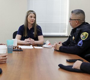 Hammond police Master Sgt. Tracy Betustak, center, speaks with Master Sgt. Joseph Martinez to discuss officer wellness among Hammond police officers.