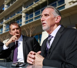 Craig Coley, right, accompanied by his attorney's Ron Kaye, center, and Nick Brustin, left, talks with reporters in Sacramento, Calif. Coley spent 39 years in prison for a murder he didn't commit.
