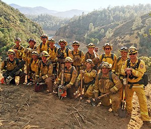In this Aug. 15, 2016 photo provided by the California Conservation Corps, a civilian firefighter crew poses for a group photo during their deployment on the Chimney Fire in San Luis Obispo County, Calif. (California Conservation Corps via AP)